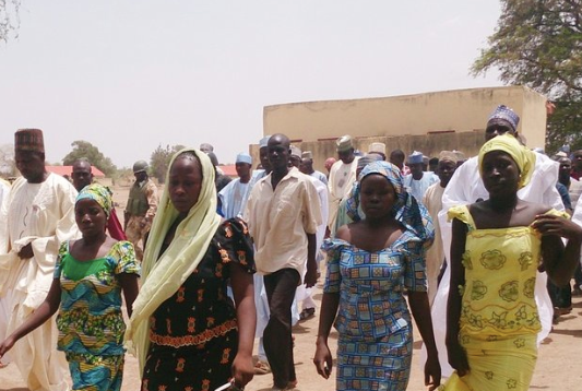 Four of the female students who were abducted reunited with their families walk in Chibok, Nigeria, April 21  Photo cred: ABC News http://abcnews.go.com/International/photos/kidnapped-nigerian-girls-23614913/image-23615049