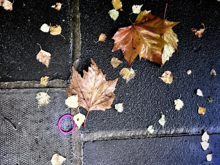 Pink hairband on a pavement